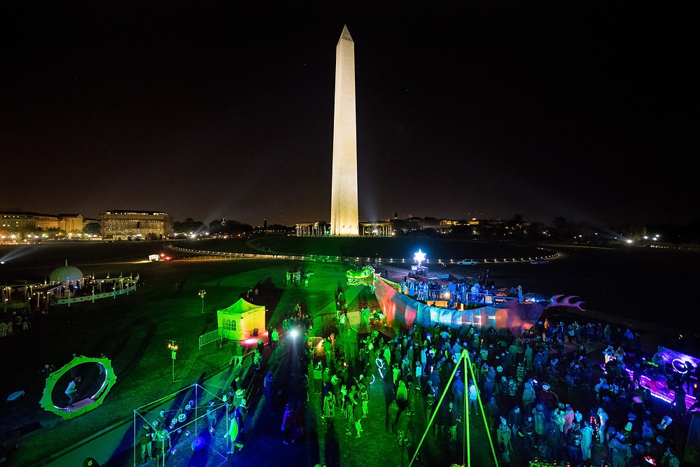 "A view of the crowd dancing at ""Abraxas: The Dragon of Self Determination"" in front of the Washington Monument during Catharsis on the Mall: A Vigil for Healing, Saturday, November 11, 2017 in Washington DC."