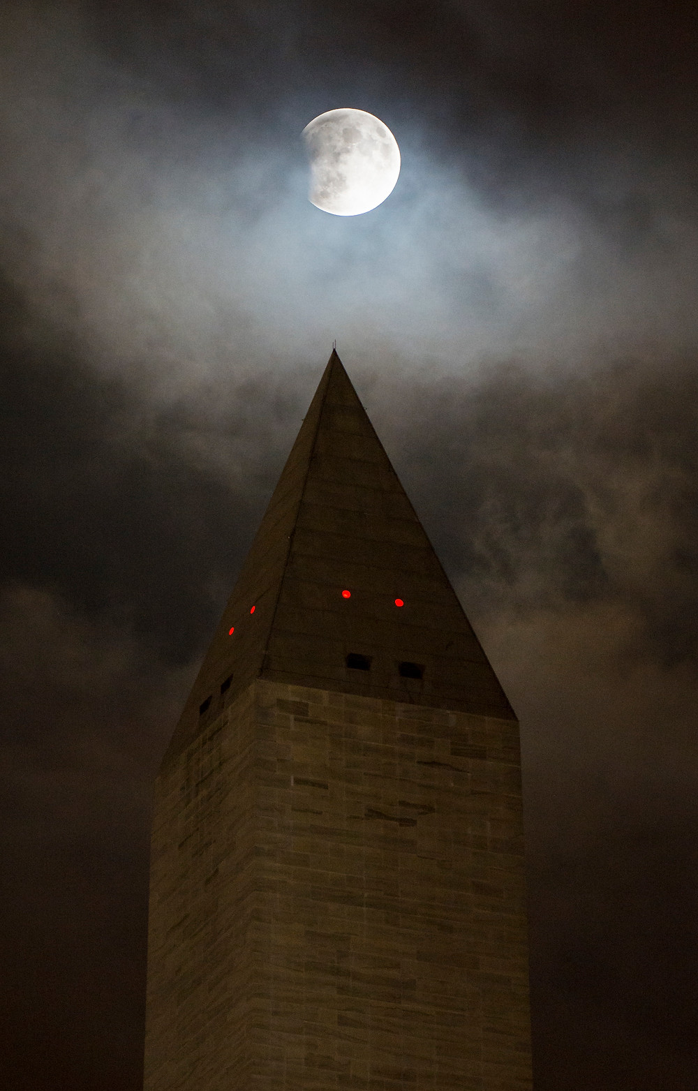 A perigee full moon, or supermoon, is seen behind the Washington Monument during a total lunar eclipse on Sunday, September 27, 2015, in Washington, DC.
