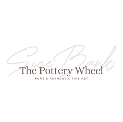 The Pottery Wheel white background.png