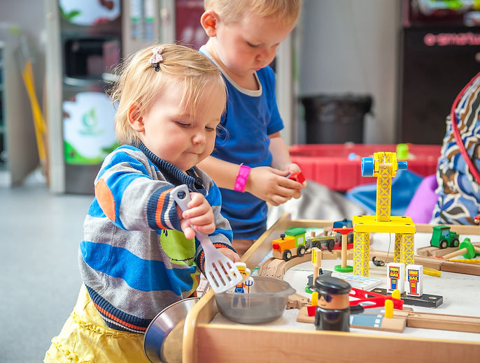 Children playing with wooden train. Toddler boy and baby girl play with crane, train and cars.jpg