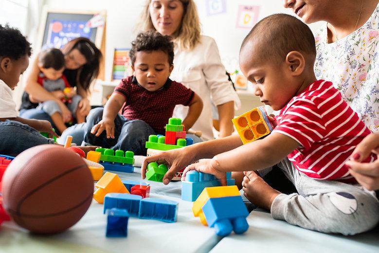 Diverse children enjoying playing with toys.jpg