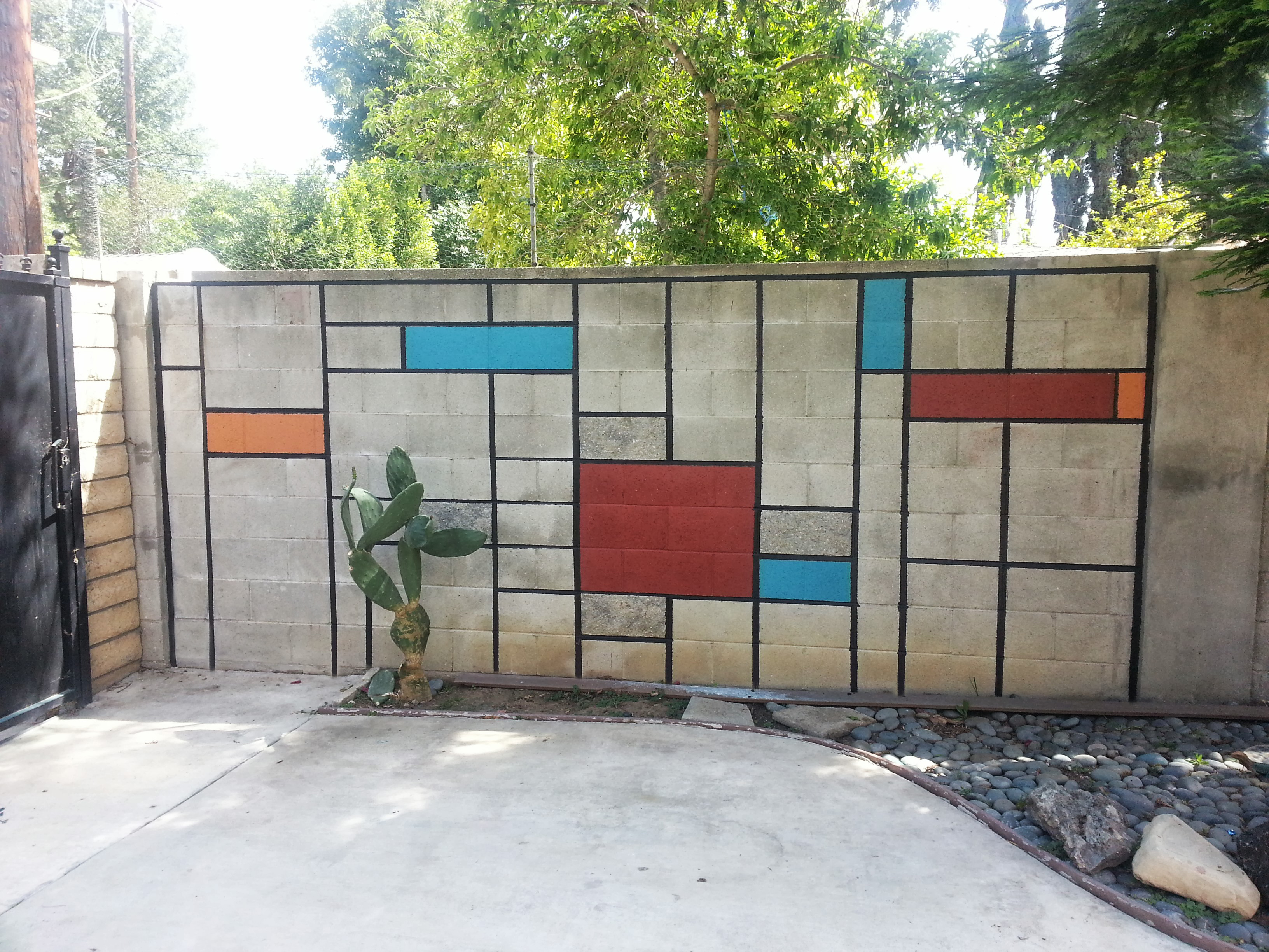Color block concrete block wall mural