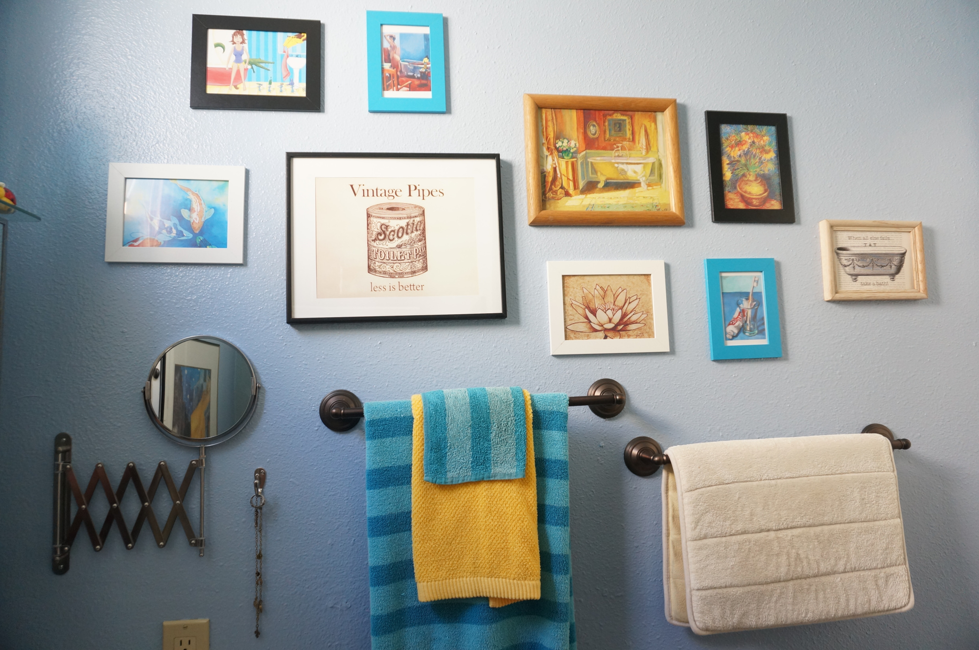 Artful small bathroom gallery wall.