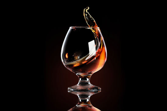 Splash of cognac in glass.jpg