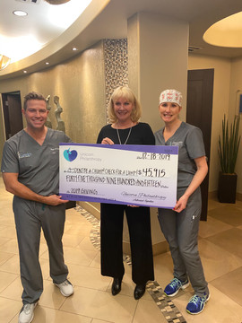 Check Presentation to Holly Rose with Dont Be A Chump! Check For A Lump!