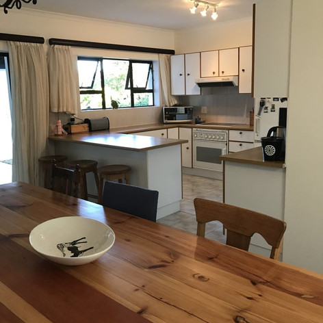 The house has a well equipped open plan kitchen with a separate scullery and braai facilities. There is an ice maker, dishwasher and extra fridge and freezer in garage.