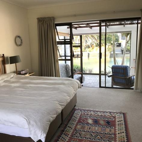 4 bedrooms (Sleeps 8), main bedroom en-suite with king bed, 2 queen-sized bedrooms with inter-leading bathroom and an additional en-suite twin room.