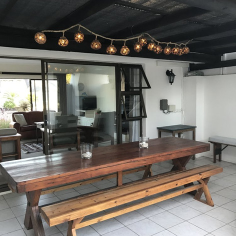 Overlooking the canals is an under-cover braai area, open patio with umbrella & furnishing.