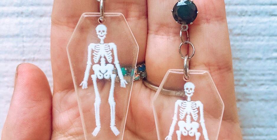 skeletons in coffins