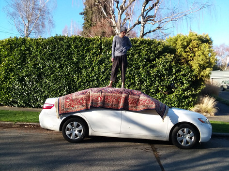 Rugcar is an on-going performance series which takes place with a rug on top of a car. The car is a mobile platform for installation and performance works. Rugcar comes from the need for dance spaces and performance opportunities that lie outside the traditional studio and theater spaces.  Through public performance, Rugcar hopes to engage an audience that wouldn't otherwise engage in performance. The intention of Rugcar is not to get people to stop and break away from their prescribed day, but to be able to catch a glimpse of something and have this glimpse invoke a later reverie.  Rugcar has allowed a dialogue to open up between me and the people who choose to watch the performance. People have come up during the performance and have asked me questions about what I am doing and why I am doing it. Rugcar allows a rare opportunity in dance to simultaneously be performing and be talking and answering questions by an audience. Part of the performance is allowing space to inform a truly curious person who may have never before been exposed to dance and performance art.