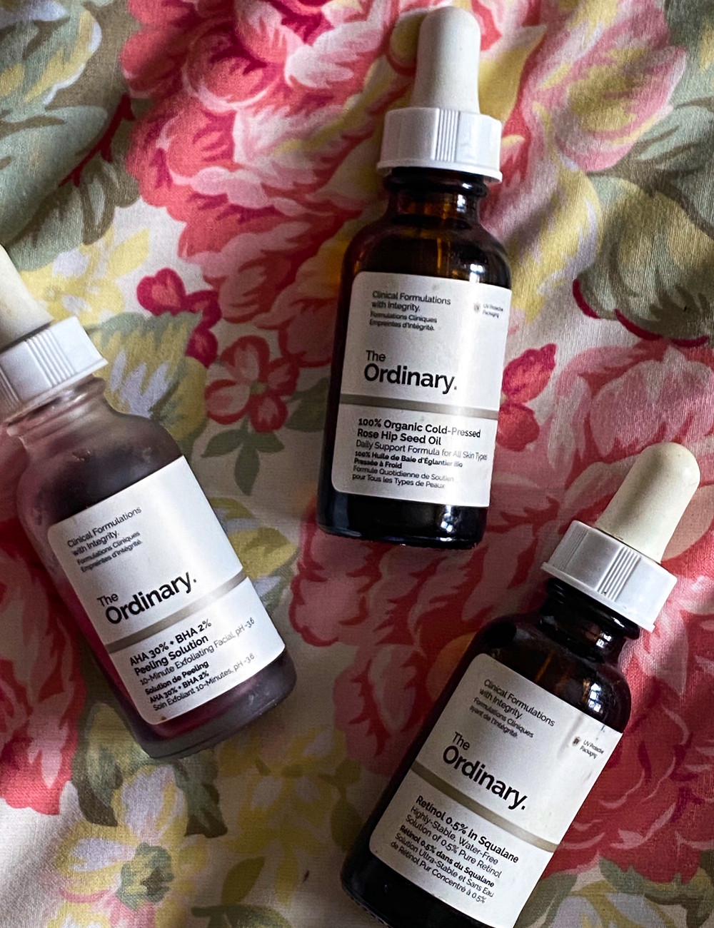 Three bottles of The Ordinary skincare