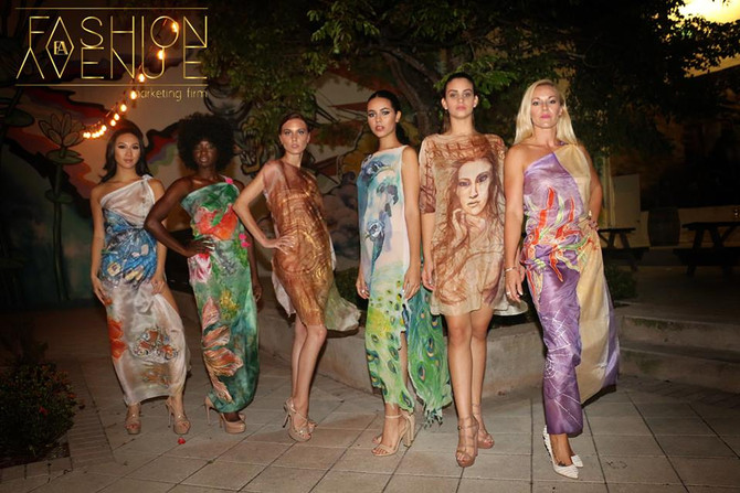At the Wine Scene for Art and Fashion Evening models are showcasing Violeta Lucce luxurious art cout