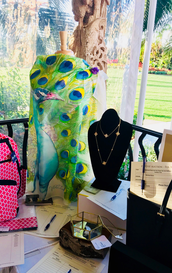 This beautiful peacock silk shawl was auctioned off at aMar a Lago for the children's Palm Beach St