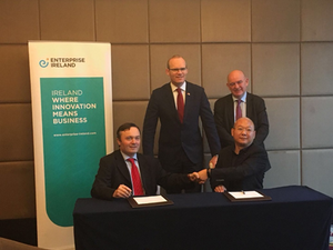 Aalto Bio's CEO, Philip Noone, signing the partner agreement with Seebio's CEO, Fyland Zhang, in the presence of An Tánaiste, Simon Coveney, and Ireland's Ambassador to China, Eoin O'Leary.