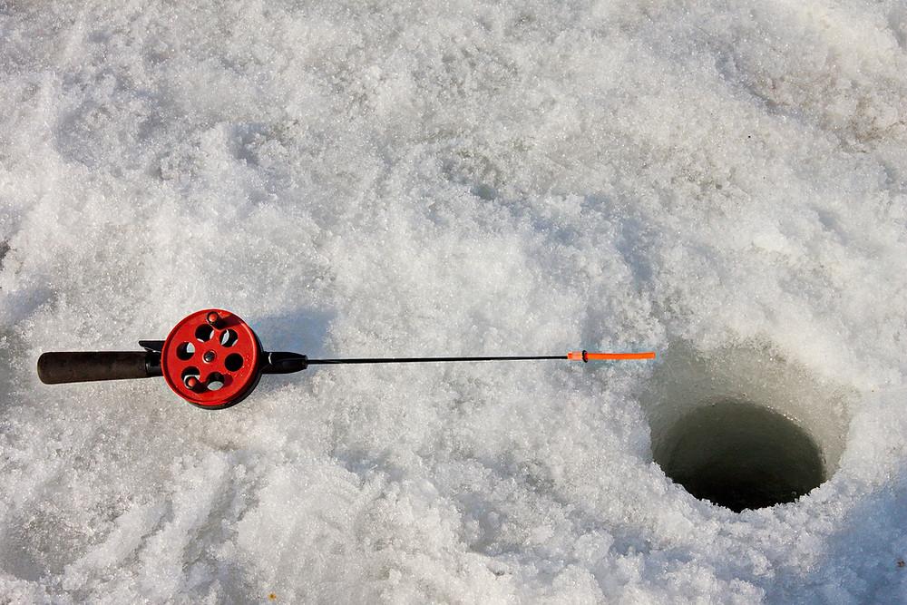 ice fishing hole in lake minocqua