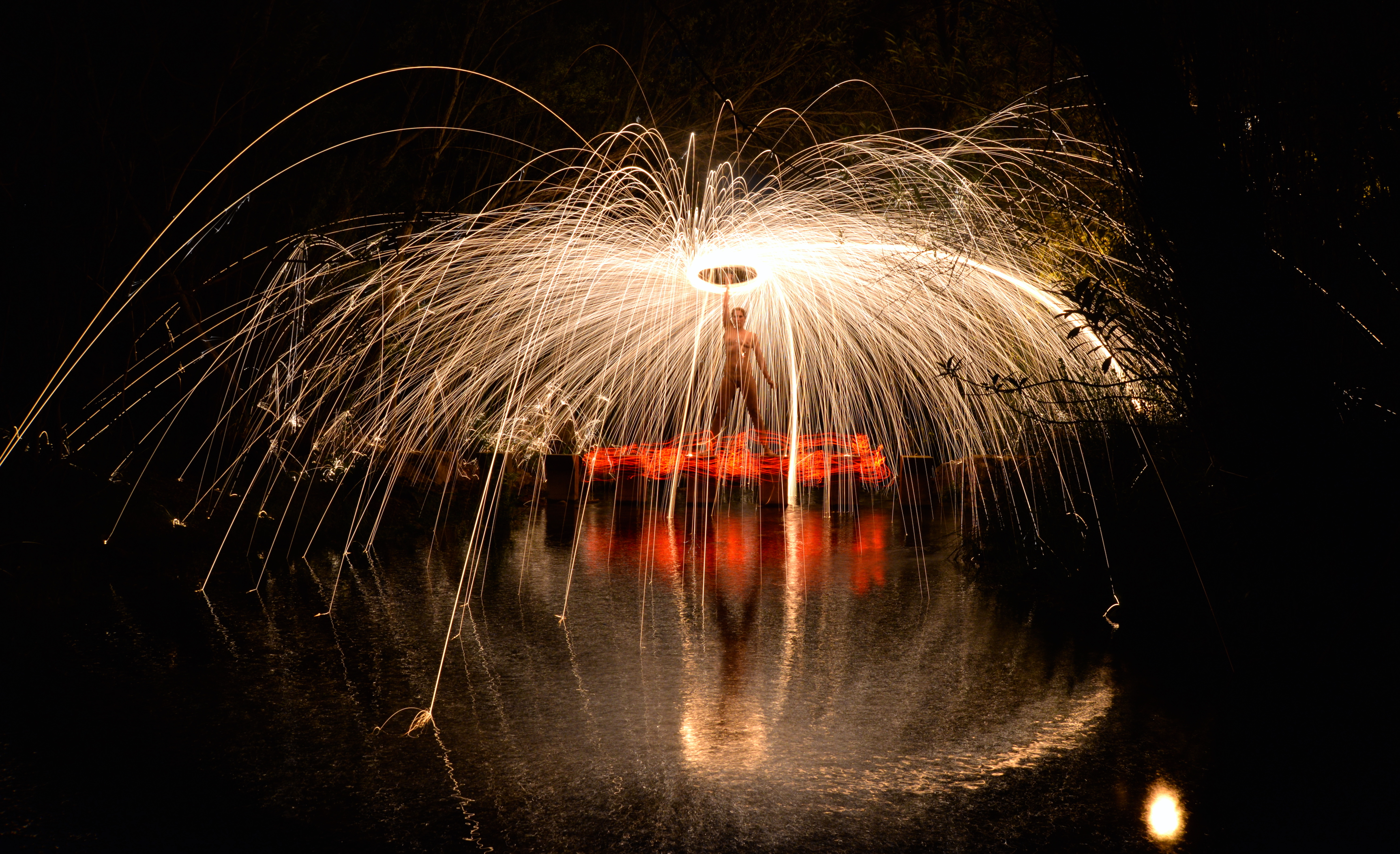 light painting steel wool river reflection