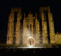 steel wool fire orb wells cathedral ball of light night photography.jpeg