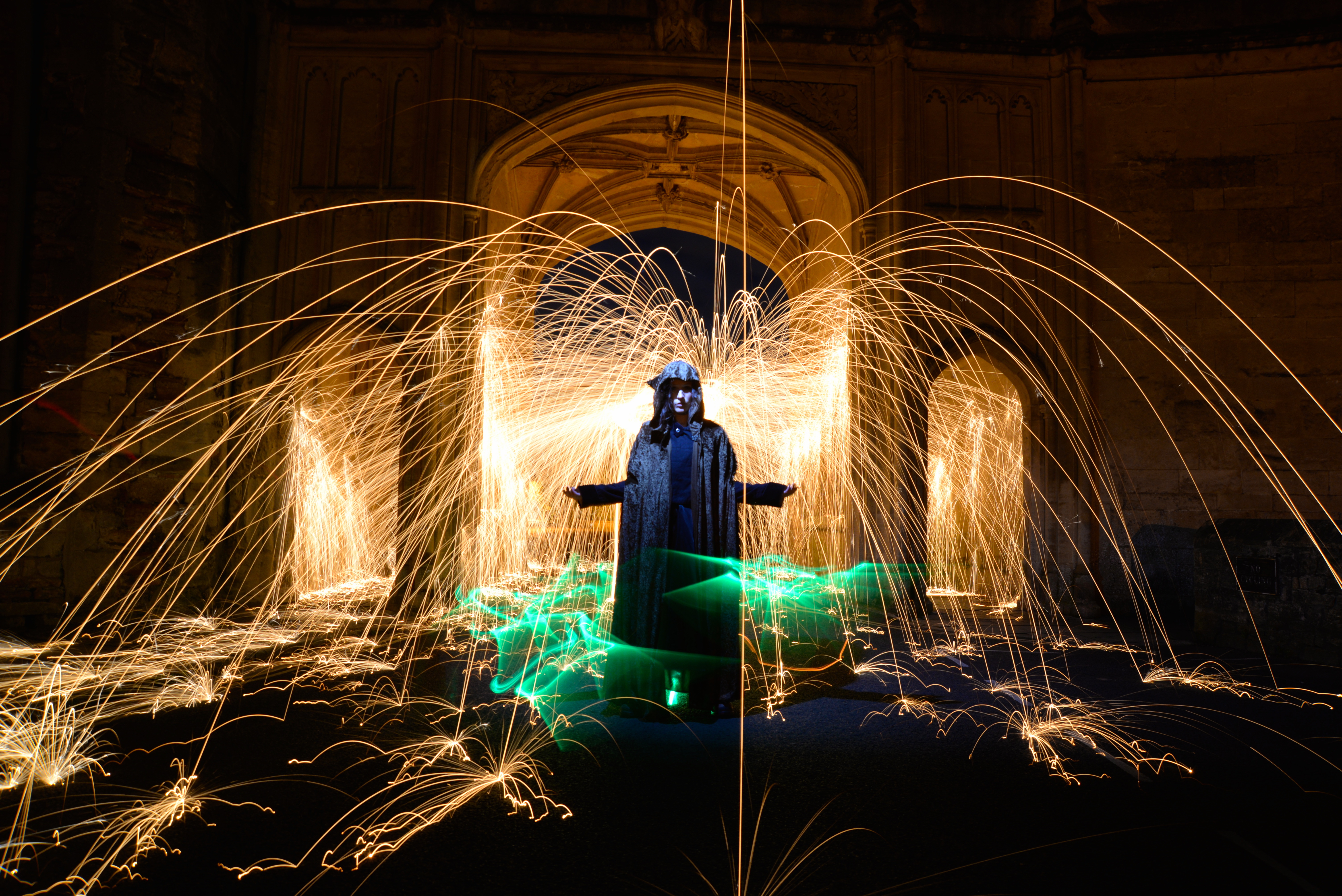 cloaked steel wool spinning light painting at wells cathedral.jpeg