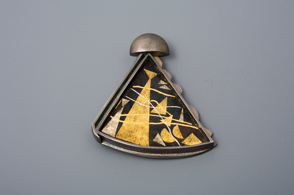 """""""Mother & Daughter"""". Brooch. 2006. Silver, 24K gold, steel. 2"""" x 3"""" x 0.5"""". Collection of Jeesuk Oh."""