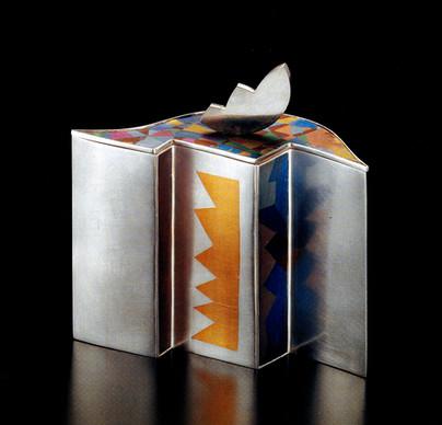 """Summerscape"". Box-container. 1987. Sterling silver, 24K gold, anodized titanium & niobium. 7"" x 7"" x 3""."