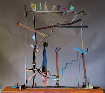 """Rainbow III"". Sculpture. 2010. Copper, brass, patina, pigment oil crayon, steel. 36"" x 42"" x 10""."