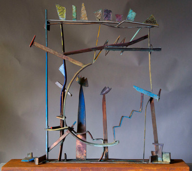 """Rainbow III"". Sculpture. 2010. Copper, brass, patina, pigment oil crayon, steel. 36"" x 42"" x 10""."