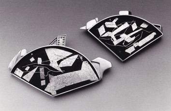 """""""Fanfair 1 & 2"""". Brooches. 1999. Fine & sterling silver, steel. 4"""" x 5"""" x 1""""; 3"""" x 4"""" x 1"""". Private collection, USA."""