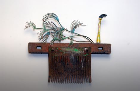 """""""New Field"""". Antique rice-leaping tool. 2005. Silver, copper, patina, acrylic paint. 21"""" x 26"""" x 3"""". Collection of Song Kwang Ja."""