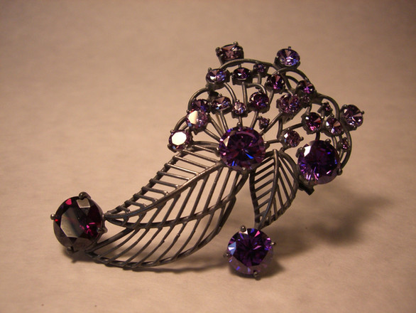 """""""Festival"""". Brooch. 2000. Silver, amethyst. 3"""" x 5"""" x 1"""". Private Collection, USA."""