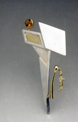 """""""Longing 2"""". Brooch. 1999. Silver, 18K gold, citrine. 6"""" x 5"""" x 1"""". Collection of the Artist."""