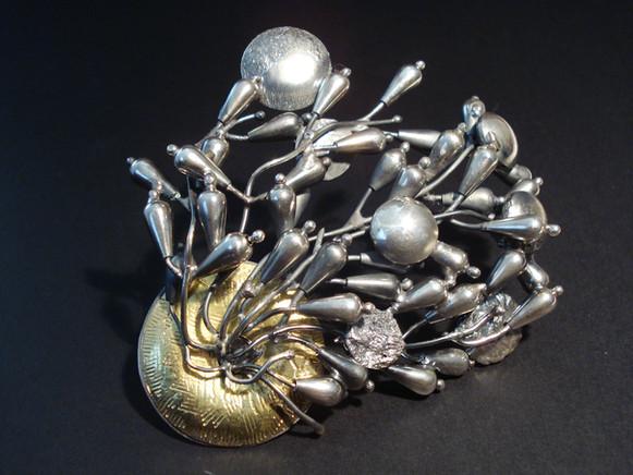 """Fantasia"". Brooch. 2007. Silver, 18K gold. Collection of Yumi Hogan, MD."