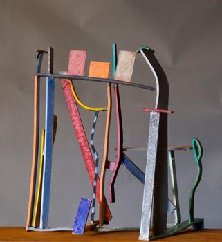"""Rainbow I"". Sculpture. 2010. Copper, brass, patina, pigment oil crayon, steel. 20"" x 16"" x 10""."