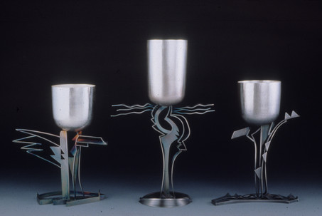 """Fantasia #3, #4, #2"". Commemorative cups. Sterling silver, 24K gold plated. 12"" x 16"" x 3""; 15"" x 16"" x 3""; 12"" x 16"" x 3""."