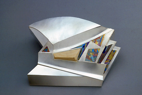 """""""SeoKyoDong Story"""". Urn-Container. 1983. Silver, titanium, ivory. 6"""" x 12"""" x 10""""."""