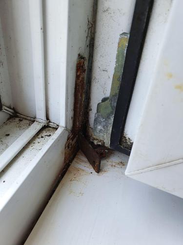 Old corroded tilt & turn bracket...