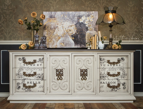Cream colored dresser painted in Dixie Belle Paint with No Pain Gel Stain Colonial Black top with redesign with Prima Transfer
