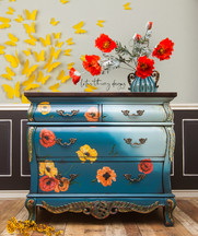Bombay accent chest painted in Dixie Belle Paint Antebellum Blue and Vintage Duck Egg with blended paint, a new top stained in No Pain Gel Stain Espresso, and redesign with Prima transfer Poppy Garden