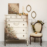 Antique tallboy dresser painted in Dixie Belle Buttercream with handpainted flowers and grass and aged
