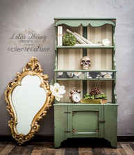 Antique, handmade mini hutch painted in green with glaze. Drawers and back panels have been decopauged. Wood appliques added for extra allure!