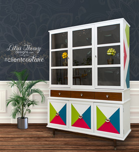 Painted MCM hutch china cabinet in white with pink, green, and blue geometric shapes.