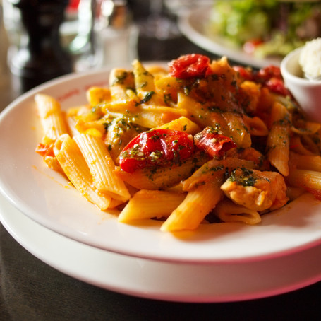 Italian penne pasta with tomatoes and pe