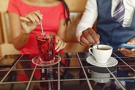 stylish-black-couple-sitting-cafe-drinki