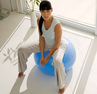 Image of a young woman sitting on a yoga ball symbolizing a method for relieving college pressures