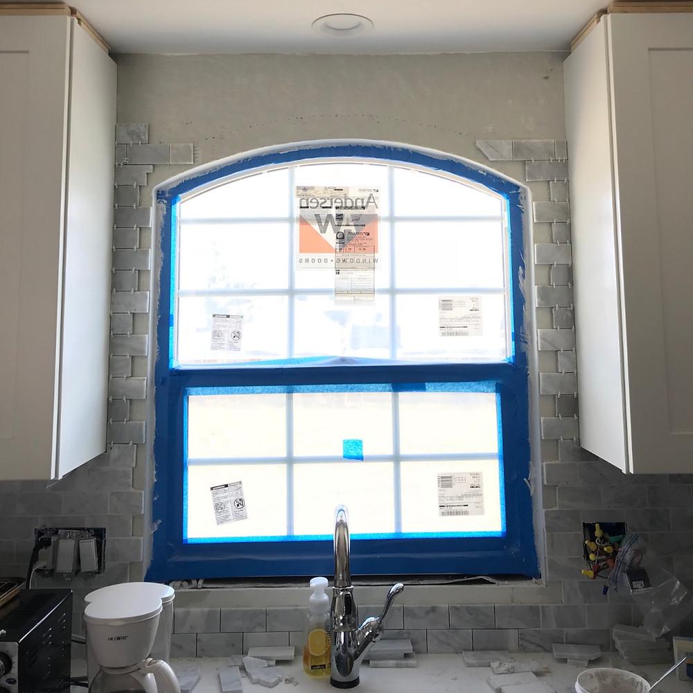 Eyebrow window and tile work