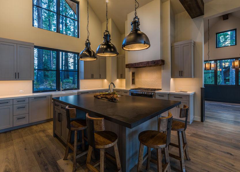 Kitchen island interior design, farmhouse style pendant lights, open floor plan
