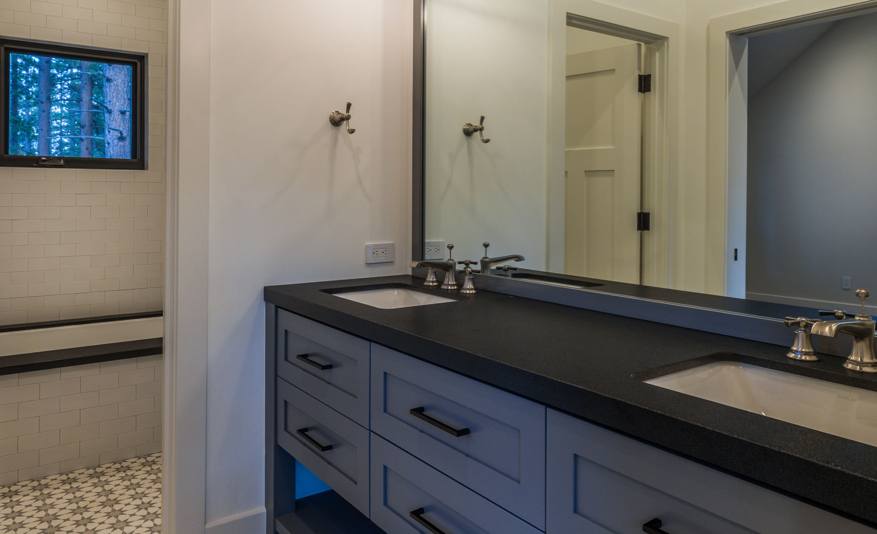 Stylish main bathroom design, tiled flooring and double sink feature