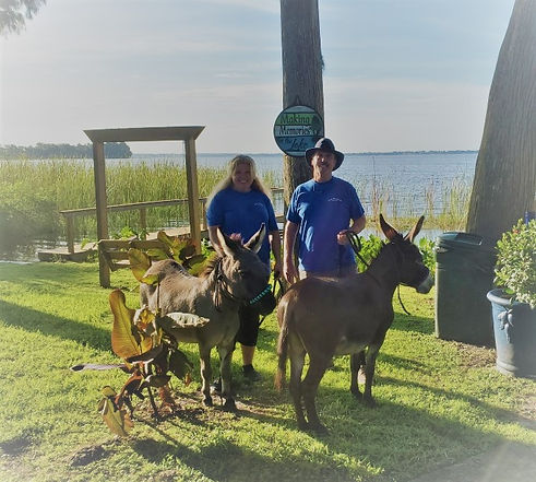 Bobby and Cheryl with donkeys.jpg