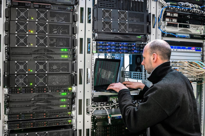 System administrator with a laptop sitti