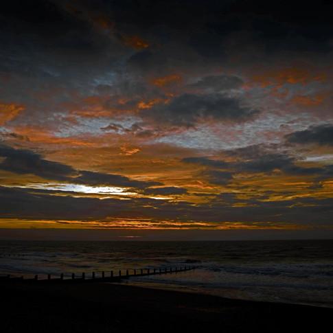 Black, orange and blue sunrise