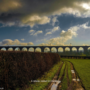 Railway viaduct in autumn with tag